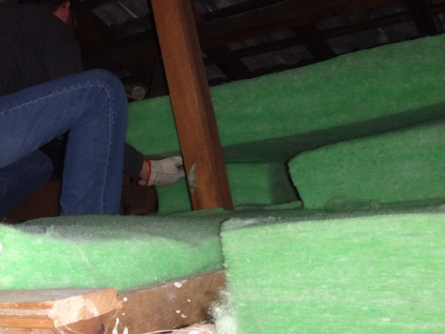 Installing Green Stuf batts in the roof